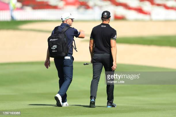 Matt Wallace of England and Henrik Stenson of Sweden talk during practice ahead of the Abu Dhabi HSBC Championship at Abu Dhabi Golf Club on January...