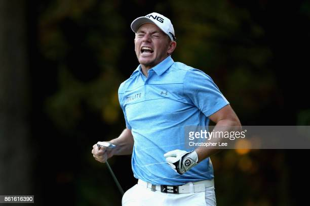Matt Wallace of England celebrates after chipping in on the 17th during the final round of the 2017 Italian Open at Golf Club Milano Parco Reale di...