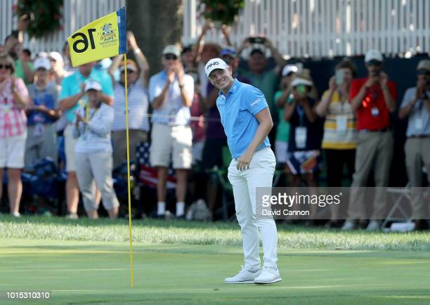 Matt Wallace of England celebrates after holing in one on the par 3 16th hole during the third round of the 100th PGA Championship at the Bellerive...