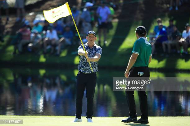 Matt Wallace of England celebrates after making a hole in one on the eighth hole during the Par 3 Contest prior to the Masters at Augusta National...
