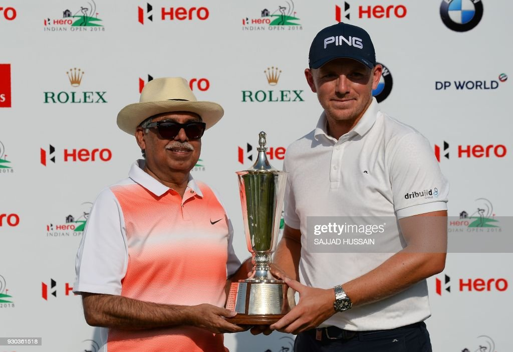 Matt Wallace of England (R) celebrates after winning the Hero Indian Open 2018 golf tournament at DLF Golf and Country Club in Gurugram on the outskirts of New Delhi on March 11, 2018. /