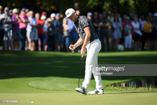 Matt Wallace of England celebrates as he plays the 18th hole during Day One of the BMW PGA Championship at Wentworth Golf Club on September 19 2019...