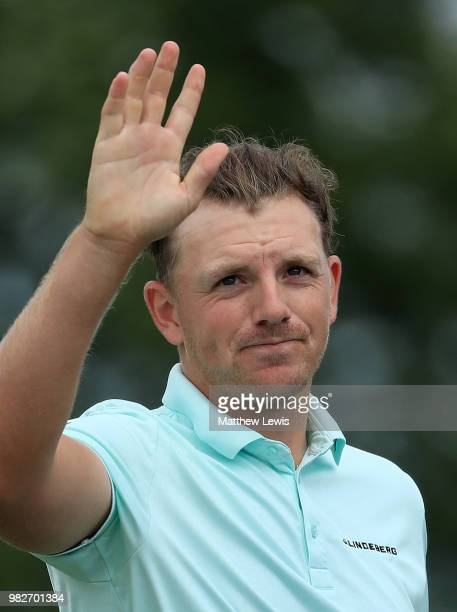 Matt Wallace of England celebrates holing his putt on the the 18th hole during the fourth round of the BMW International Open at Golf Club Gut...