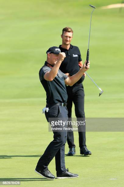 Matt Wallace of England celebrates victory on the 18th green as Sebasatian Heisele of Germany looks on during the final round on day four of the Open...