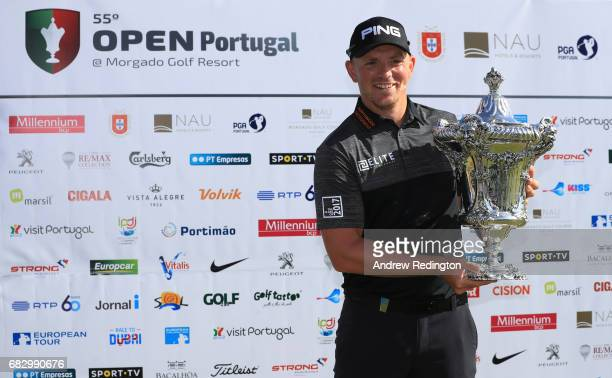 Matt Wallace of England celebrates victory with the trophy after the final round on day four of the Open de Portugal at Morgado Golf Resort on May 14...