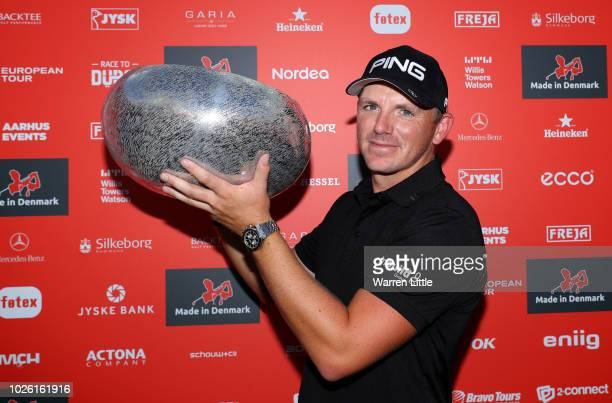 Matt Wallace of England celebrates victory with the trophy in the playoff during the final round on day four of the Made in Denmark played at the...