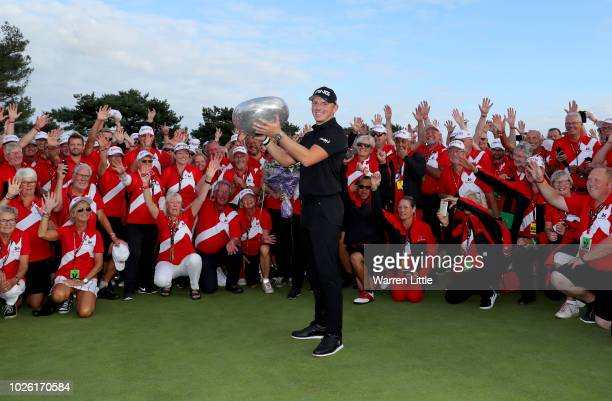 Matt Wallace of England celebrates victory with the trophy in the playoff with voulunteers during the final round on day four of the Made in Denmark...