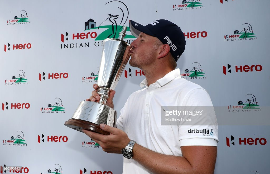 Matt Wallace of England celebrates with the trophy after winning the play off during day four of The Hero Indian Open at Dlf Golf and Country Club on March 11, 2018 in New Delhi, India.