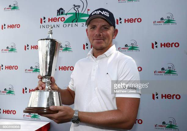 Matt Wallace of England celebrates with the trophy after winning the play off during day four of The Hero Indian Open at Dlf Golf and Country Club on...