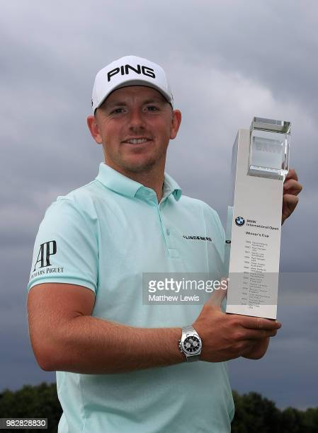 Matt Wallace of England celebrates with the trophy after winning the BMW International Open at Golf Club Gut Larchenhof on June 24 2018 in Cologne...