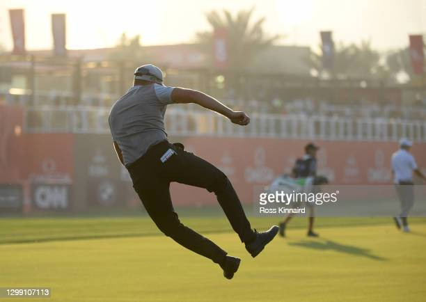 Matt Wallace of England does a little skip after he second shot on the par five 18th hole during the first round of the Omega Dubai Desert Classic at...