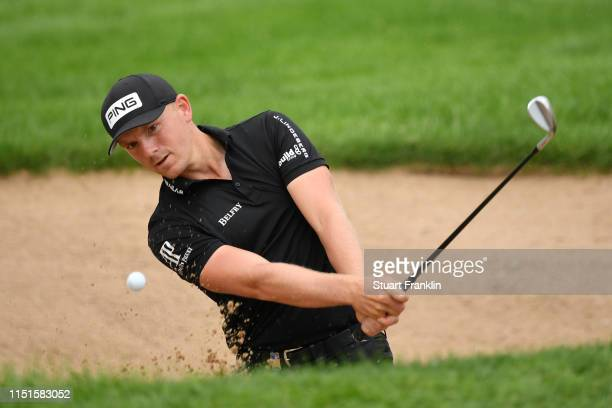 Matt Wallace of England hits a bunker shot on the 10th hole during day four of the BMW International Open at Golfclub Munchen Eichenried on June 23...