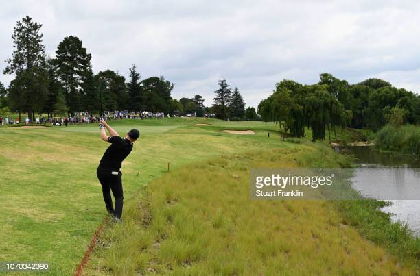 Matt Wallace of England hits a shot from the rough on the 2nd hole during the final round on day four of the South African Open at Randpark Golf Club...