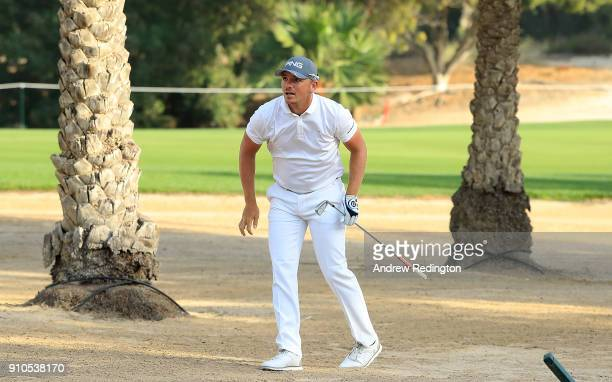 Matt Wallace of England hits his second shot on the 12th hole during round two of the Omega Dubai Desert Classic at Emirates Golf Club on January 26...