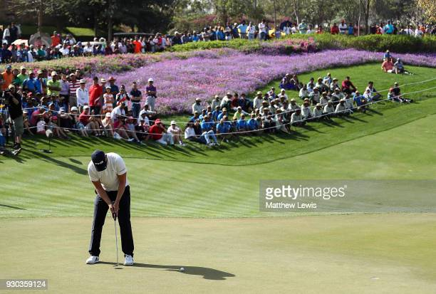 Matt Wallace of England hits the winning putt on the 18th hole during a play off against Andrew Johnson of England on day four of The Hero Indian...