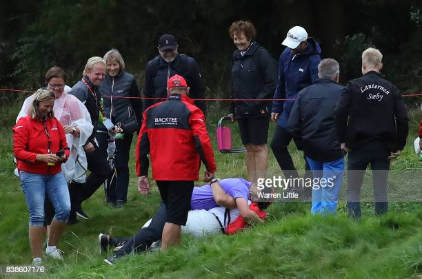 Matt Wallace of England hugs a marshall who found his ball on the 18th hole during day one of Made in Denmark at Himmerland Golf Spa Resort on August...