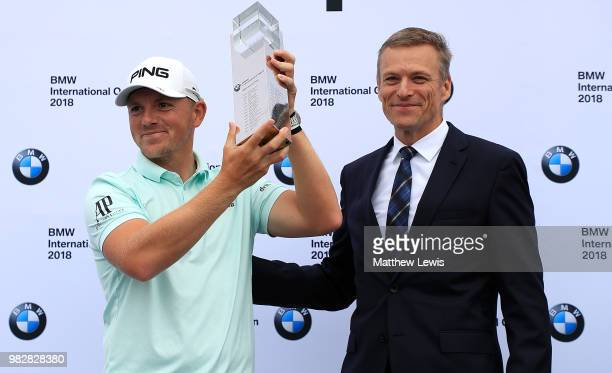Matt Wallace of England is presented the trophy by Peter van Binsbergen Head of the German Sales Subsidiary for the BMW Group after winning the BMW...