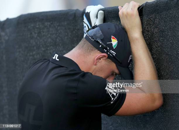 Matt Wallace of England is visibly upset after missing a short par putt on the par 3 17th hole during the final round of the 2019 Arnold Palmer...
