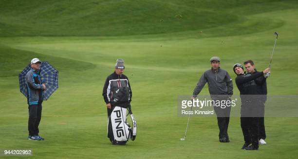 Matt Wallace of England is watched by Robert Rock of England during a practice round prior to the Open de Espana at Centro Nacional de Golf on April...