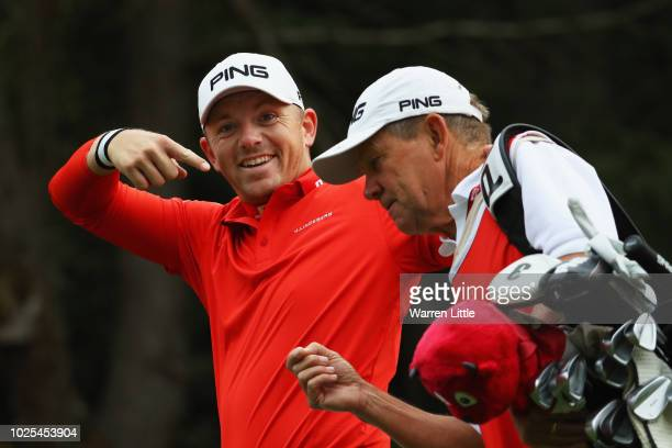 Matt Wallace of England jokes with his caddie Ronan Flood during day two of the Made in Denmark played at the Silkeborg Ry Golf Club on August 31...