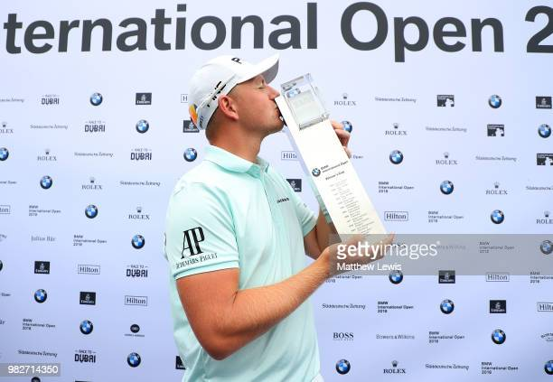 Matt Wallace of England kisses the trophy after winning the BMW International Open at Golf Club Gut Larchenhof on June 24 2018 in Cologne Germany