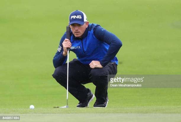 Matt Wallace of England line up a putt on the 9th hole during day one of the European Tour KLM Open held at The Dutch on September 14 2017 in Spijk...