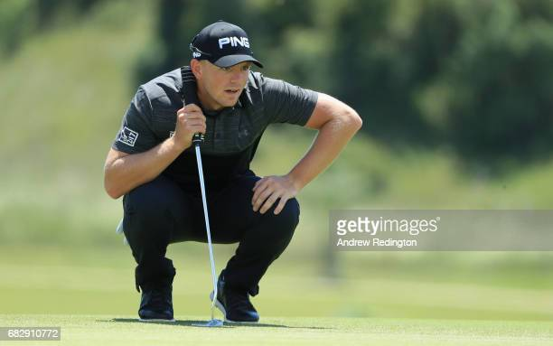 Matt Wallace of England lines up a putt during the final round on day four of the Open de Portugal at Morgado Golf Resort on May 14 2017 in Portimao...