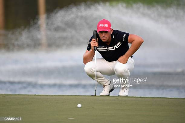 Matt Wallace of England lines up a putt on hole eighteen during Day Two of the Omega Dubai Desert Classic at Emirates Golf Club on January 25 2019 in...
