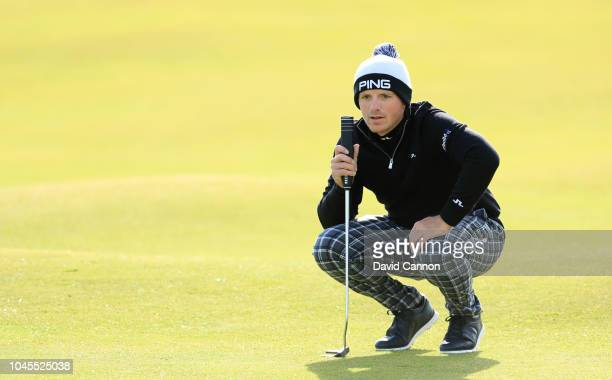 Matt Wallace of England lines up a putt on the second hole during the first round of the 2018 Alfred Dunhill Links Championship on The Old Course at...