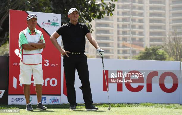 Matt Wallace of England looks on with his caddie during day three of the Hero Indian Open at Dlf Golf and Country Club on March 10 2018 in New Delhi...