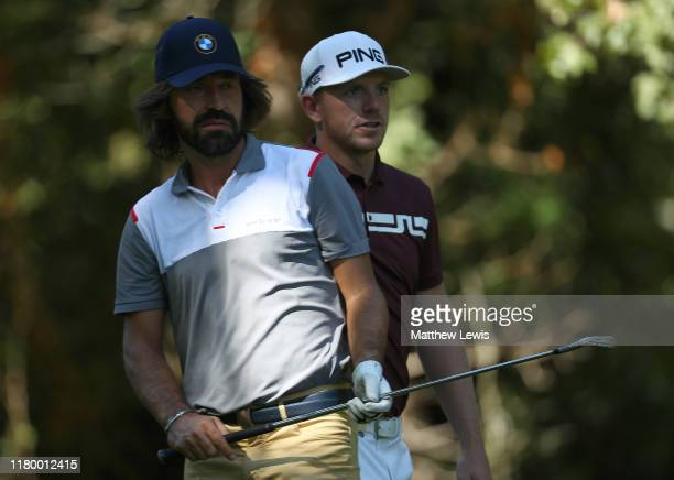 Matt Wallace of England pictured with ExItalian footballer Andrea Pirlo during a Practice round ahead of the Italian Open at Olgiata Golf Club on...