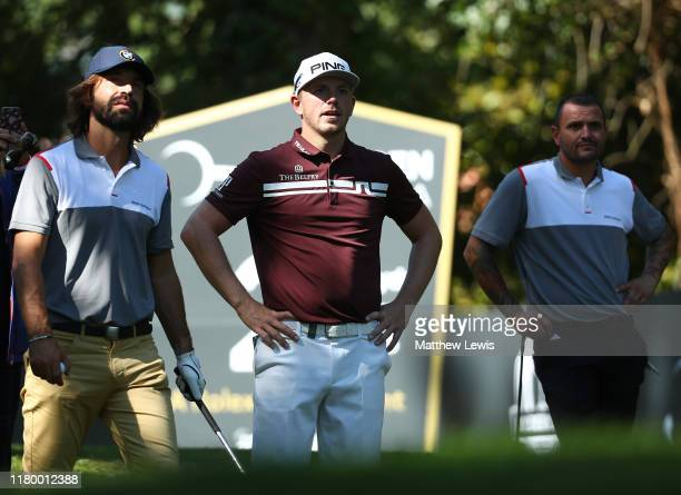 Matt Wallace of England pictured with ExItalian footballer's Andrea Pirlo and Simone Pepe during a Practice round ahead of the Italian Open at...