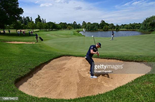 Matt Wallace of England plays a bunker shot during the third round of the South African Open at Randpark Golf Club on December 8, 2018 in...