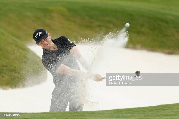 Matt Wallace of England plays a shot from a bunker on the 16th hole during the final round of the World Golf Championship-FedEx St Jude Invitational...