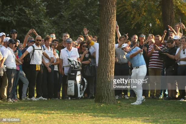 Matt Wallace of England plays a shot from behind a tree on the 18th during Day Four of the Italian Open at Golf Club Milano Parco Reale di Monza on...