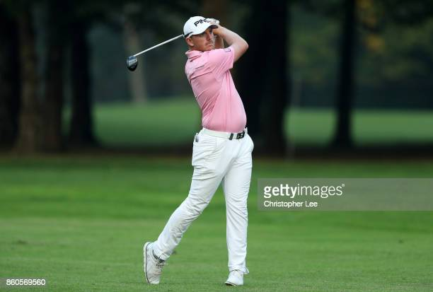 Matt Wallace of England plays a shot on the 9th hole on Day One of the Italian Open at Golf Club Milano Parco Reale di Monza on October 12 2017 in...