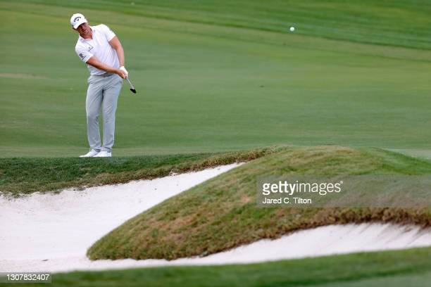 Matt Wallace of England plays a shot on the third hole during the first round of The Honda Classic at PGA National Champion course on March 18, 2021...