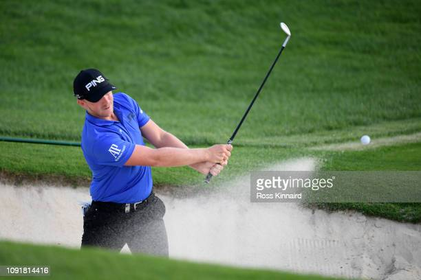 Matt Wallace of England plays his second shot on the 17th hole during Day One of the Saudi International at Royal Greens Golf and Country Club on...