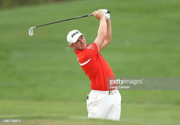 Matt Wallace of England plays his second shot on the par 4, third hole during the third round of the DP World Tour Championship on the Earth Course...