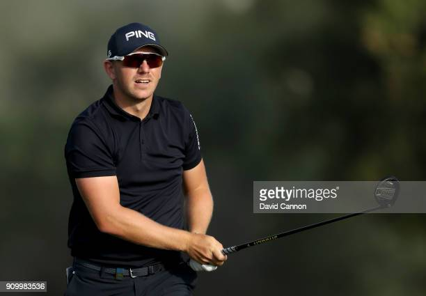 Matt Wallace of England plays his second shot on the par 5 third hole during the first round of the Omega Dubai Desert Classic on the Majlis Course...