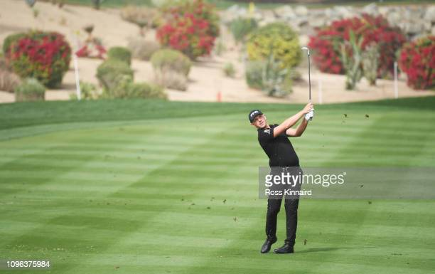 Matt Wallace of England plays his second shot on the third hole during Day Four of the Abu Dhabi HSBC Golf Championship at Abu Dhabi Golf Club on...