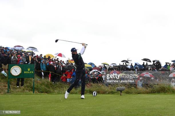 Matt Wallace of England plays his shot from the seventh tee during the first round of the 148th Open Championship held on the Dunluce Links at Royal...