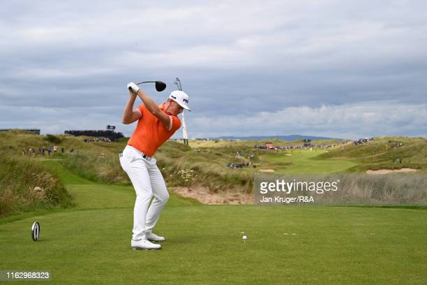 Matt Wallace of England plays his shot from the seventh tee during the second round of the 148th Open Championship held on the Dunluce Links at Royal...