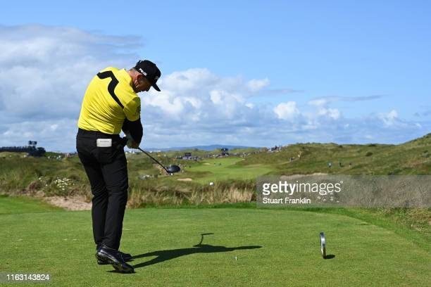 Matt Wallace of England plays his shot from the seventh tee during the third round of the 148th Open Championship held on the Dunluce Links at Royal...