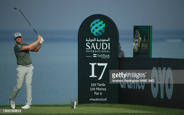 Matt Wallace of England plays his tee shot on the 17th hole during Day One of the Saudi International powered by SoftBank Investment Advisers at...