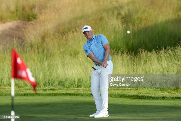 Matt Wallace of England plays his third shot on the par 4, 10th hole during the first round of the 117th US Open Championship at Erin Hills on June...