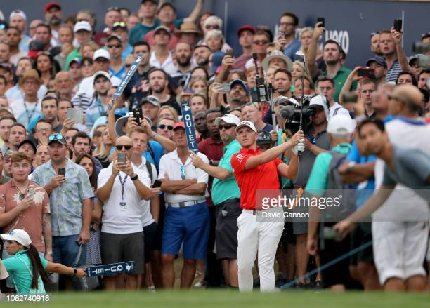 Matt Wallace of England plays his third shot on the par 5, 18th hole during the third round of the DP World Tour Championship on the Earth Course at...