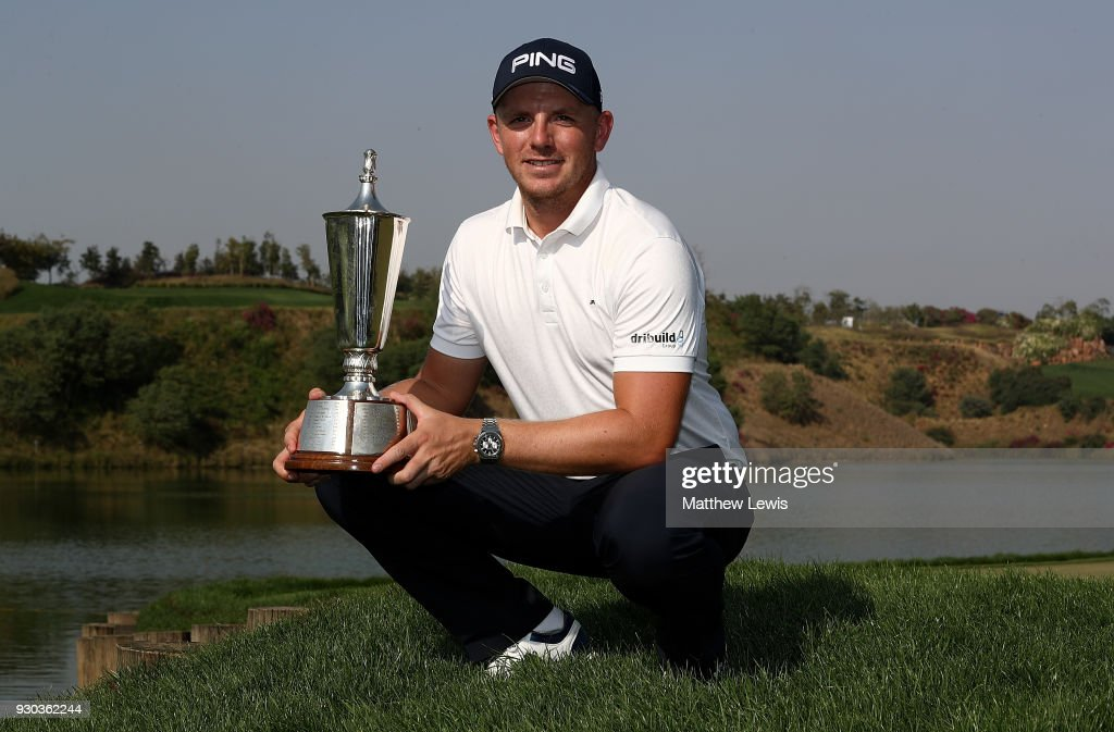 Matt Wallace of England poses for a picture with the trophy after winning the play off during day four of The Hero Indian Open at Dlf Golf and Country Club on March 11, 2018 in New Delhi, India.