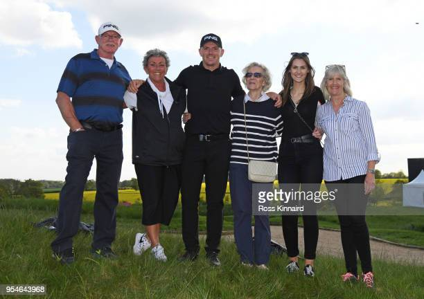 Matt Wallace of England poses with his family during the ProAm tournament ahead of the GolfSixes at The Centurion Club on May 4 2018 in St Albans...