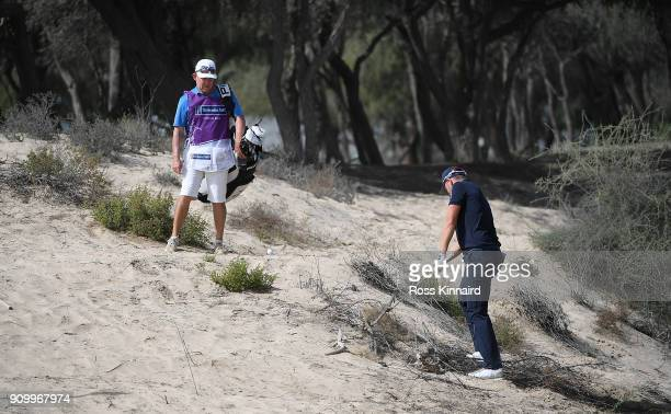 Matt Wallace of England prepares to play his second shot on the 13th hole during round one of the Omega Dubai Desert Classic at Emirates Golf Club on...